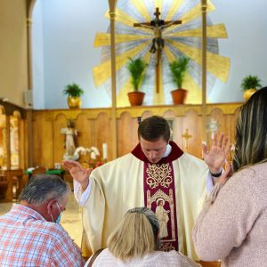 Newly ordained Fr. Michael Masteller celebrates Mass at Resurrection Church in Boyle Heights after pandemic restrictions were lifted in the Archdiocese of Los Angeles.