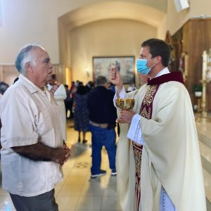 Fr. Michael distributes communion at Resurrection Church.