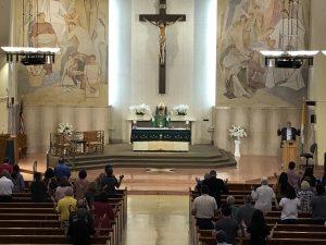 LA Catholics attend Mass  at St. Anthony Church.