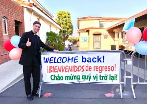 Father Matt Wheeler welcomes parishioners back to Mass at St. Anthony Church in San Gabriel on June 20, his birthday.